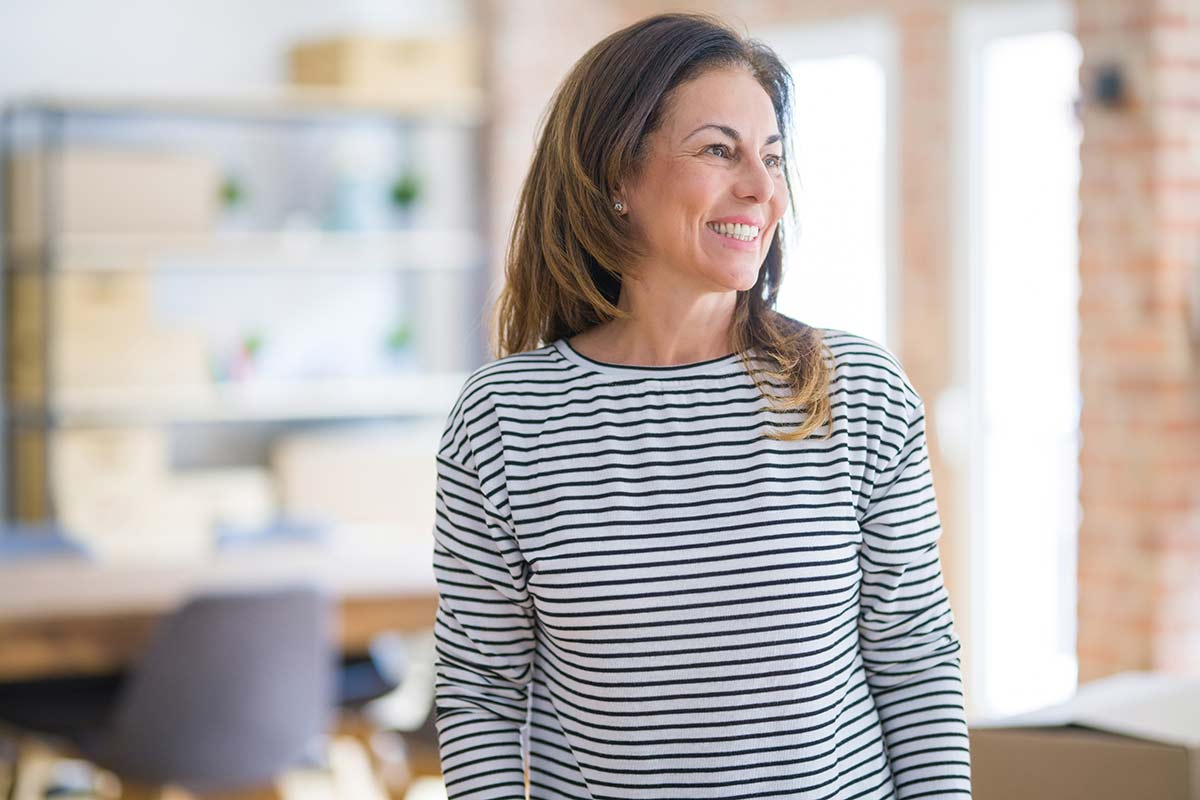 Woman smiling and being treated for hormone imbalances