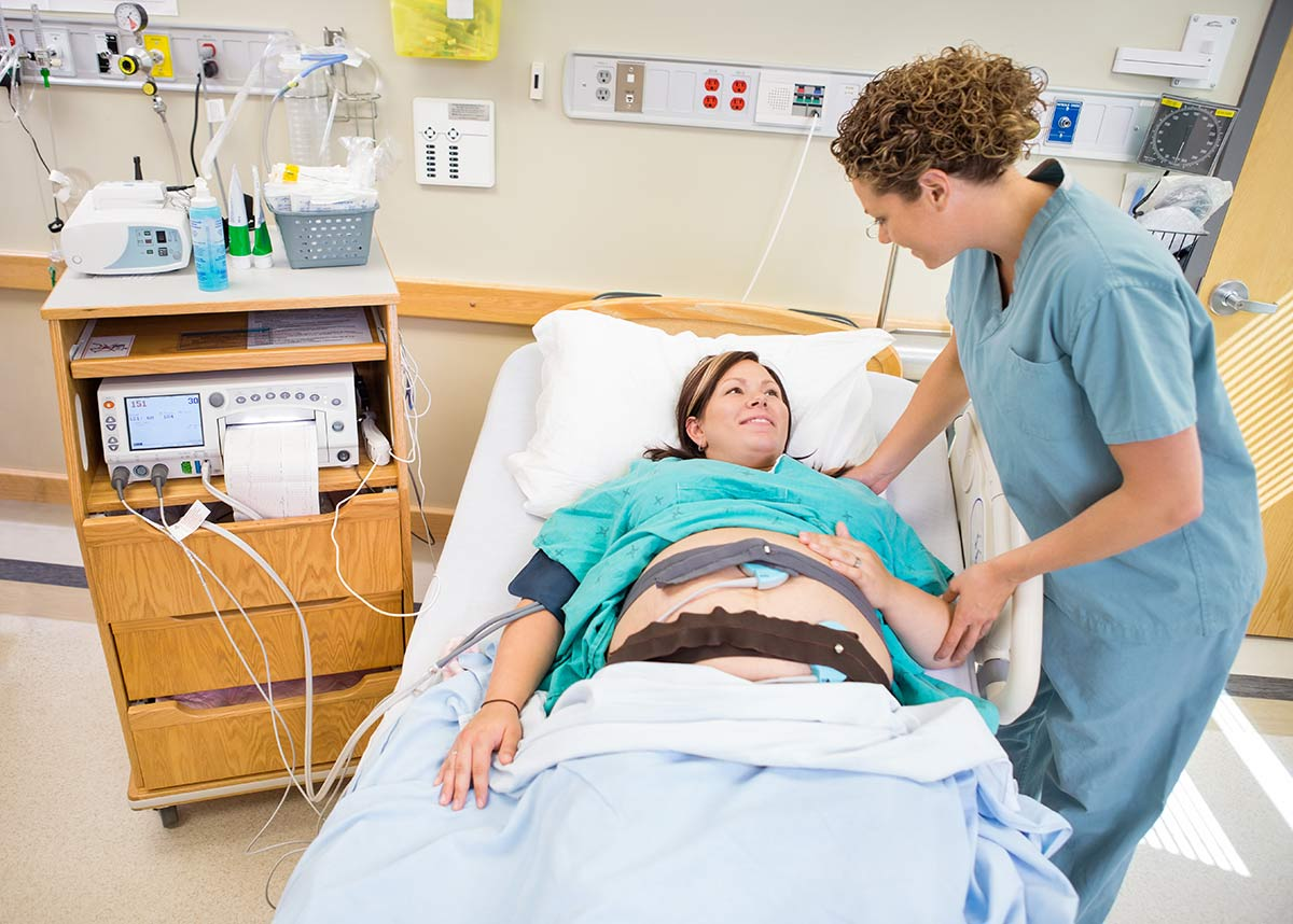 Woman smiling after getting an epidural during labor